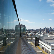 "February 19, 2015 - New York, NY : Rising high above Greenpoint, Brooklyn, Newtown Creek Wastewater Treatment Plant's eight ""egg-shaped"" digesters are connected by glass-walled walkways. The plant, located in Greenpoint, Brooklyn, is the largest of New York City's 14 wastewater treatment plants. Bacteria in the digesters break down sludge (organic material removed from sewage) into water, carbon dioxide, methane, and ""digested sludge."" The city burns the methane to create energy and uses the digested sludge as a fertilizer. CREDIT: Karsten Moran for The New York Times"
