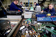 Workers are taking electronic devices apart | 2006