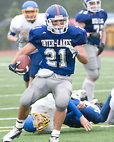 Running back Kevin Brady breaks through the Gilford defense for a touchdown during Saturdays Division VI matchup between Inter Lakes and Gilford squads.  (Karen Bobotas/for the Laconia Daily Sun)