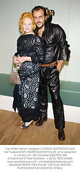 Top British fashion designer VIVIENNE WESTWOOD and her husband MR ANDREAS KRONTHALER, at a reception in London on 14th October 2002.			PEA 388