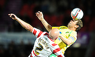 Doncaster - Tuesday September 14th, 2010: Norwich City's Grant Holt and Doncaster Rovers's James O'Connor in action during the NPower Championship match at Keepmoat Stadium, Doncaster. (Pic by Dave Howarth/Focus Images)