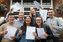 "© Licensed to London News Pictures. 15/08/2016. Sutton Coldfield, West Midlands,UK. Bishops Vesey's Grammar School pupils celebrating their A level results. Pictured from left, Ben Brady, Daniel Carruthers, Sofia Kaur, Jemina Richardson-Jones, Lucy Parize, Rory Gaskin, all 18. Headmaster Dominic Robson said, ""The pupils had done amazingly well, achieving 80% A star and B grades especially given the change to the marking of the A level system this year. Photo credit: Dave Warren/LNP"
