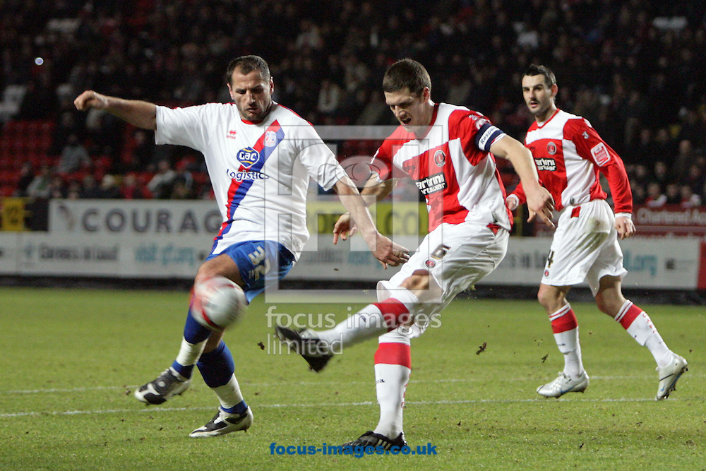 London - Tuesday December 27th, 2009: Mark Hudson (R) of Charlton Athletic in action against Shefki Kuqi of Crystal Palace during the Coca Cola Championship match, London. (Pic by Mark Chapman/Focus Images)