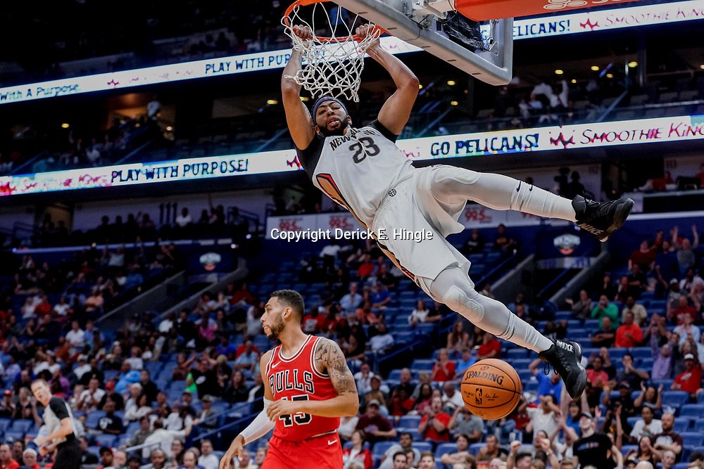 Oct 3, 2017; New Orleans, LA, USA; New Orleans Pelicans forward Anthony Davis (23) dunks over Chicago Bulls guard Denzel Valentine (45) during the second half of a NBA preseason game at the Smoothie King Center. The Bulls defeated the Pelicans 113-109. Mandatory Credit: Derick E. Hingle-USA TODAY Sports