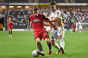 Grimsby Town midfielder Harry Clifton (15) battles for possession  with Milton Keynes Dons defender Jordan Moore-Taylor (15) during the EFL Sky Bet League 2 match between Milton Keynes Dons and Grimsby Town FC at stadium:mk, Milton Keynes, England on 21 August 2018.