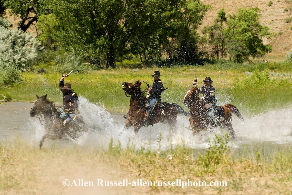 Custers Last Stand Reenactment, Crow Indian Reservation on Little Bighorn River, Montana, 7th Cavalry soldiers cross Little Bighorn to attack Indian Camp, <br /> MODEL RELEASED