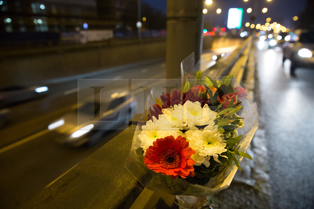© Licensed to London News Pictures. 18/12/2017. Birmingham, UK. The scene this morning in Lea Bank Underpass, Edgbaston, where six people lost their lives in a road traffic accident. Pictured, a flowers left above the scene of the accident during the night. Photo credit: Dave Warren/LNP