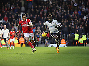 Fulham striker, Moussa Dembele (25) taking on Charlton Athletic defender, Jorge Teixeira (50) during the Sky Bet Championship match between Fulham and Charlton Athletic at Craven Cottage, London, England on 20 February 2016. Photo by Matthew Redman.