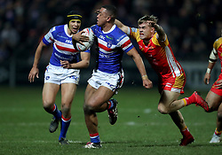 Wakefield Trinity's Reece Lyne and Catalan Dragons' Lewis Tierney in action during the Betfred Super League match at Belle Vue, Wakefield.