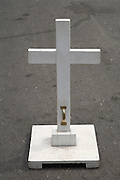 transportable cross placed on the street