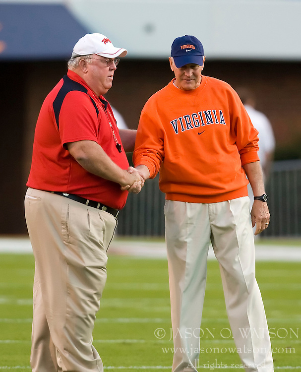 Virginia head coach Al Groh meets with Maryland head coach Ralph Friedgen before a football game.  The Virginia Cavaliers defeated the Maryland Terrapins 31-0 in NCAA football at Scott Stadium on the Grounds of the University of Virginia in Charlottesville, VA on October 4, 2008.