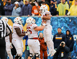Nov 18, 2017; Morgantown, WV, USA; Texas Longhorns running back Kyle Porter (21) celebrates with teammates after running for a touchdown during the third quarter against the West Virginia Mountaineers at Milan Puskar Stadium. Mandatory Credit: Ben Queen-USA TODAY Sports