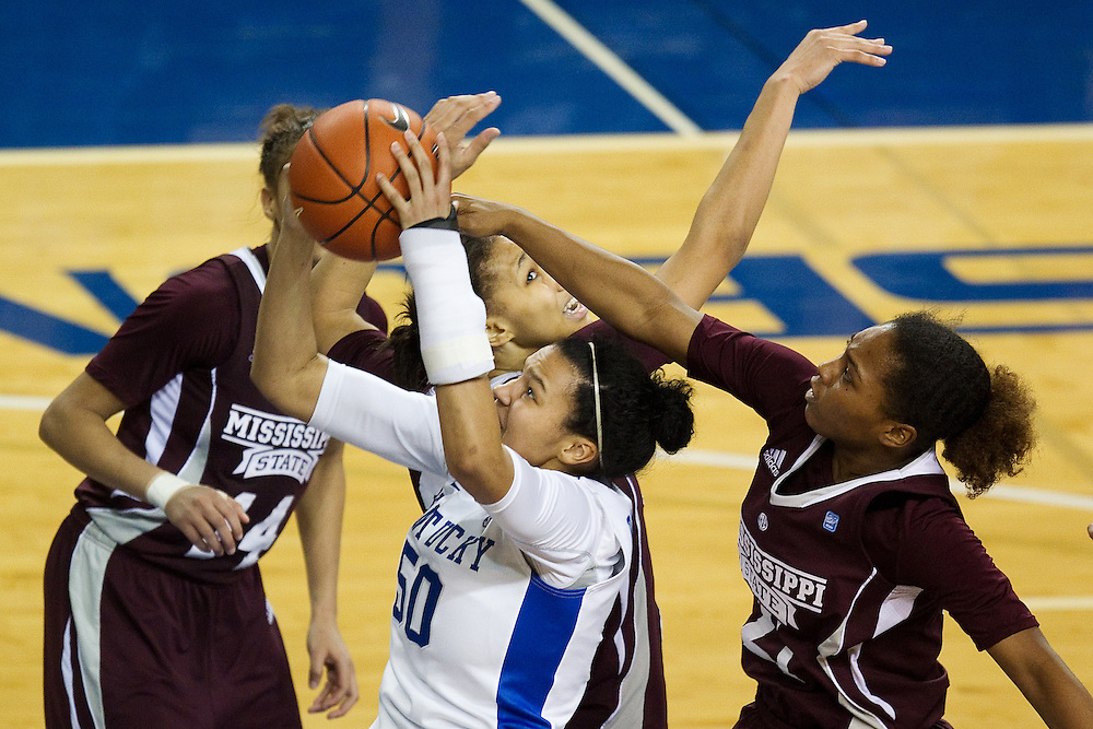 Mississippi State guard Jerica James, right, contests a shot by UK forward/center Azia Bishop in the second half. The University of Kentucky Women hosted Mississippi State University Thursday, Jan. 17, 2013 at Memorial Coliseum in Lexington. Photo by Jonathan Palmer