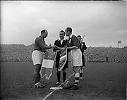 16/11/1952<br /> 11/16/1952<br /> 16 November 1952<br /> Soccer International: Ireland v France at Dalymount Park, Dublin. The game was a 1-1 draw. The captains Roger Marche (France, left) and Johnny Carey (Ireland, right) exchange pennons before kick off watched by referee Albert Alsteen.