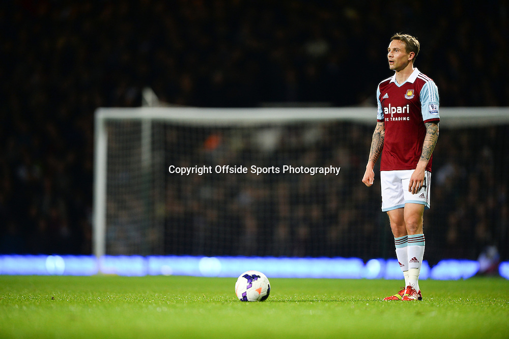 26 March 2014 - Barclays Premier League - West Ham United v Hull City - Matthew Taylor of West Ham United prepares to take a free kick - Photo: Marc Atkins / Offside.