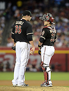 PHOENIX, AZ - JUNE 08:  Catcher Miguel Montero #26 and pitcher Trevor Cahill #35 of the Arizona Diamondbacks talk on the mound in the game against San Francisco Giants at Chase Field on June 8, 2013 in Phoenix, Arizona. The Giants defeated the Diamondbacks 10-5.  (Photo by Jennifer Stewart/Getty Images)