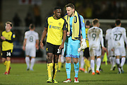 Lucas Akins of Burton Albion (10) and Simon Eastwood of Oxford United (1) have a chat during the EFL Sky Bet League 1 match between Burton Albion and Oxford United at the Pirelli Stadium, Burton upon Trent, England on 11 February 2020.