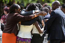 Hyde Park, London, July 7th 2015. Families of the victims and survivors of the 7/7 bombings in London gather at Hyde Park and are joined by the Duke of Cambridge Prince William at an emotional service commemorqating the Islamist terrorist bombing outrage that happened on London's transport network, claiming 57 lives and left scores of people injured. PICTURED: Family members and survivors lay single yellow gerberers at the memorial.