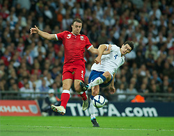 LONDON, ENGLAND - Tuesday, September 6, 2011: Wales' Darcy Blake and England's Gareth Barry during the UEFA Euro 2012 Qualifying Group G match at Wembley Stadium. (Pic by Gareth Davies/Propaganda)