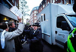 © under license to London News Pictures.  The police van with Julian Assange leaves Westminster Magistrates court  (07/12/10) where Julian Assange appeared on sexual assault charges. Photo credit should read: Olivia Harris/ London News