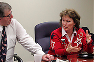 Dr. Tony Corvo of Beavercreek (left) and Kelly Kohls of Springboro during a roundtable discussion of the Republican debate in Arizona, Wednesday, February 22, 2012.