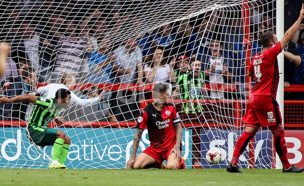 Andy Barcham of AFC Wimbledon scores to make it 1-2 during the Sky Bet League 2 match between Crawley Town and AFC Wimbledon at the Checkatrade.com Stadium, Crawley, England on 15 August 2015. Photo by Ken Sparks.