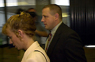 Heather M. Miller, left, is accompanied by her husband, Kevin, whom she is accused of trying to murder with poison potatoes, as they enter Bucks County Court, Tuesday, Sept. 19, 2000, in Doylestown, Pa. She was found guilty. (Photo by William Thomas Cain/Photojournalist.cc)