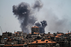 May 4, 2019 - Gaza City, Palestine, 04 May 2019. Israeli airstrikes target a Palestinian resistance post in the south of Gaza City. According to the Israeli army, Israeli forces hit a number of military posts in the Palestinian enclave including two rocket launchers during air strikes in response to the firing of dozens of rockets from Gaza into Israel earlier in the day. The rocket attacks from Gaza had been in response to the killing of two Palestinians the previous day when an Israeli aircraft attacked a Hamas post following the wounding of two Israeli soldiers by a Gaza border protester (Credit Image: © Ahmad Hasaballah/IMAGESLIVE via ZUMA Wire)