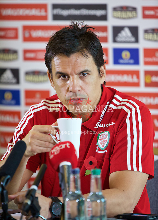 CARDIFF, WALES - Thursday, November 12, 2015: Wales' manager Chris Coleman, with a cup of coffee, during a press conference at the Vale of Glamorgan ahead of the International Friendly against the Netherlands. (Pic by David Rawcliffe/Propaganda)