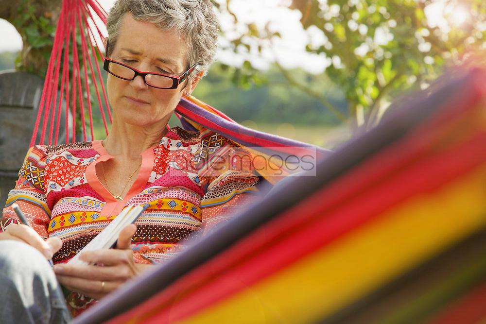 Woman on Hammock Writing