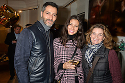 Left to right, NICK HOPPER, JASMINE HEMSLEY and NIKKI SHEHADEH at a private view of Stephen Webster's new White Kite collection held at his flagship store at 130 Mount Street, London on 24th November 2016.