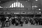 Passengers wait for a train in the train station Paris, France
