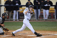 Ole Miss' Matt Snyder (33) hits a  RBI double in the third inning vs. Jackson State at Oxford-University Stadium in Oxford, Miss. on Tuesday, March 15, 2011.