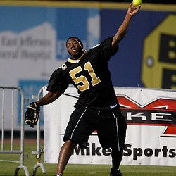 Apr 28, 2010; Metairie, LA, USA; Jonathan Vilma (51) throws the ball during the Heath Evans Foundation charity softball featuring teammates of the Super Bowl XLIV Champion New Orleans Saints at Zephyrs Field.  Mandatory Credit: Derick E. Hingle-US-PRESSWIRE.