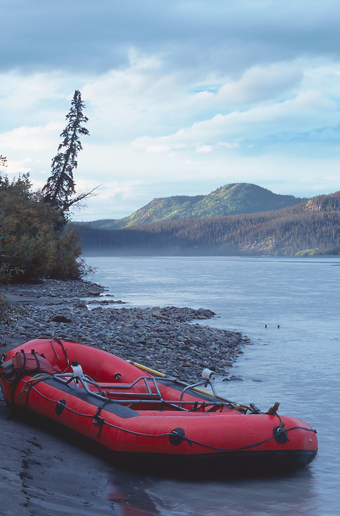 Rafting at Nerelna Creek on Chitina River in Wrangell-St. Elias National Park in Southcentral Alaska.  Fall.  Afternoon.