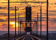 A intermodal train prepares to cross the massive lift bridge built by the Lehigh Valley Railroad.