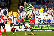 Forest Green Rovers midfielder Darren Carter (12) goes up for the header during the Vanarama National League match between Lincoln City and Forest Green Rovers at Sincil Bank, Lincoln, United Kingdom on 25 March 2017. Photo by Simon Davies.