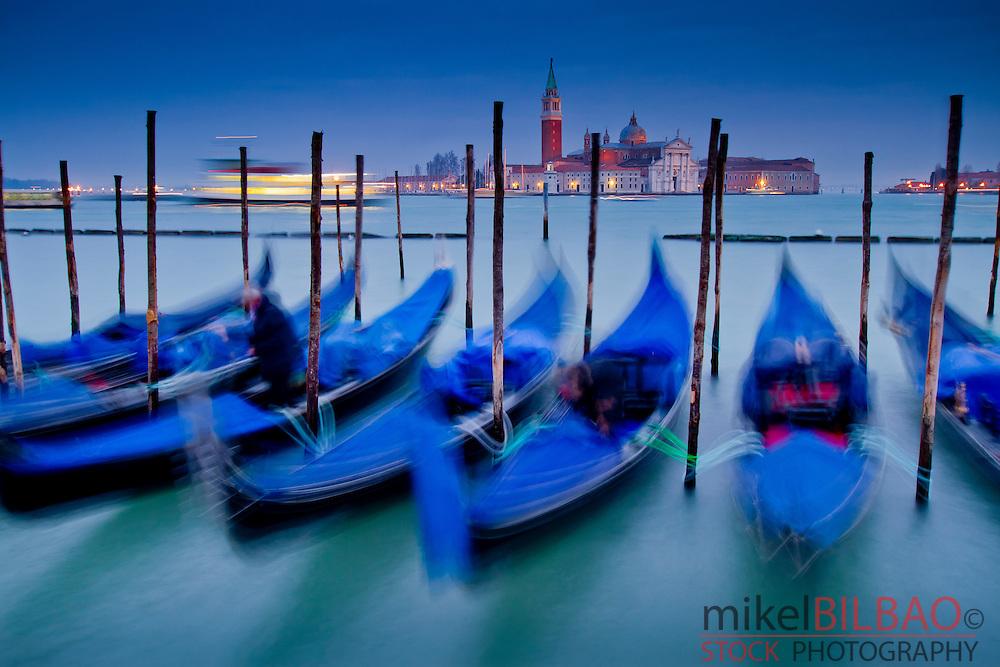 Gondolas and San Giorgio Maggiore Island. St Mark´s Square. Venice, Italy.