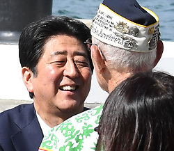 """US-Präsident Barack Obama und Japans Premier Shinzo Abe beim Gedenken an die Opfer des japanischen Angriffs auf Pearl Harbor vor 75 Jahren / 271216<br /> <br /> <br /> <br /> ***After giving a speech at Pearl Harbor in Hawaii on Dec. 27, 2016, Japanese Prime Minister Shinzo Abe talks to a U.S. veteran who survived the Japanese attack there in 1941. In the speech, Abe offered his """"sincere and everlasting condolences"""" for those who died in the attack.***"""