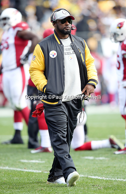 Pittsburgh Steelers head coach Mike Tomlin walks back to the sideline during the 2015 NFL week 6 regular season football game against the Arizona Cardinals on Sunday, Oct. 18, 2015 in Pittsburgh. The Steelers won the game 25-13. (©Paul Anthony Spinelli)