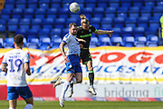 Tranmere Rovers James Norwood(10) and Forest Green Rovers Joseph Mills(23) jump for the ball during the EFL Sky Bet League 2 match between Tranmere Rovers and Forest Green Rovers at Prenton Park, Birkenhead, England on 19 April 2019.