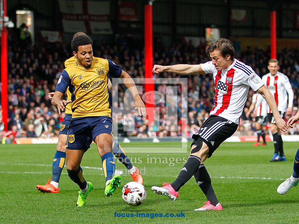 Korey Smith of Bristol City and Lasse Vibe of Brentford during the Sky Bet Championship match between Brentford and Bristol City at Griffin Park, London<br /> Picture by Mark D Fuller/Focus Images Ltd +44 7774 216216<br /> 01/04/2017