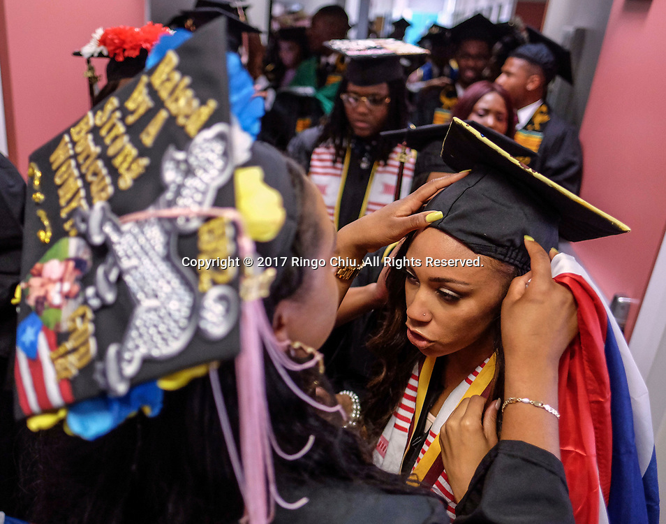 RIVERSIDE, CA - JUNE 11, 2017: Graduates Latisha Robertson, left, helds fixing an academic hat on Arielk Dean before the Black Graduation Ceremony at University of California, Riverside, Sunday June 11, 2017. (Photo by Ringo H.W. Chiu / For The Times)(Photo by Ringo Chiu)<br /> <br /> Usage Notes: This content is intended for editorial use only. For other uses, additional clearances may be required.