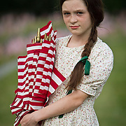 Erica Neemeyer, 11, planted flags with her family at the Soldiers National Cemetery, during the Sesquicentennial Anniversary of the Battle of Gettysburg, Pennsylvania on Sunday, June 30, 2013.  A pivotal moment in the Civil War, over 50,000 soldiers were killed, wounded or missing after 3 days of battle from July 1-3, 1863.  Later that year, President Abraham Lincoln returned to Gettysburg to deliver his now famous Gettysburg Address to dedicate the cemetery there for the Union soldiers who died in battle.  John Boal photography