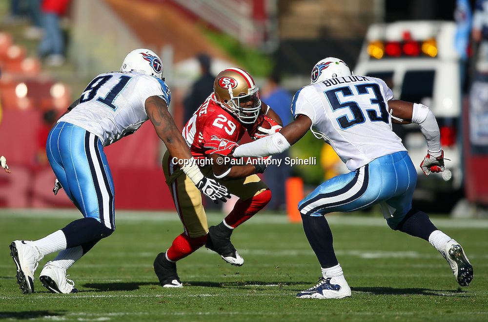 San Francisco 49ers running back Glen Coffee (29) runs the ball while trying to avoid a gang tackle by Tennessee Titans linebacker Keith Bulluck (53) and defensive tackle Jason Jones (91) during the NFL football game against the Tennessee Titans, November 8, 2009 in San Francisco, California. The Titans won the game 34-27. (©Paul Anthony Spinelli)