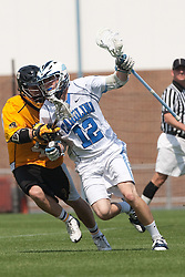 09 May 2009: North Carolina Tar Heels midfielder Bobby McAuley (12) during a 15-13 win over the University of Maryland - Baltimore County Retrievers on Fetzer Field in Chapel Hill, NC.
