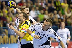 Uros Zorman (#24) of Celje vs Christian Zeitz of Kiel during the handball match between RK Celje Pivovarna Lasko (SLO) and TWH Kiel (GER) in 4th Round of Velux EHF Men's Champions League, on October 17, 2010 in Arena Zlatorog, Celje, Slovenia.  (Photo By Vid Ponikvar / Sportida.com)