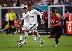 July 31, 2018 - Miami Gardens, Florida, USA - Real Madrid C.F. defender Theo Hernandez (15) drives the ball past Manchester United F.C. defender Matteo Darmian (36) during an International Champions Cup match between Real Madrid C.F. and Manchester United F.C. at the Hard Rock Stadium in Miami Gardens, Florida. Manchester United F.C. won the game 2-1. (Credit Image: © Mario Houben via ZUMA Wire)