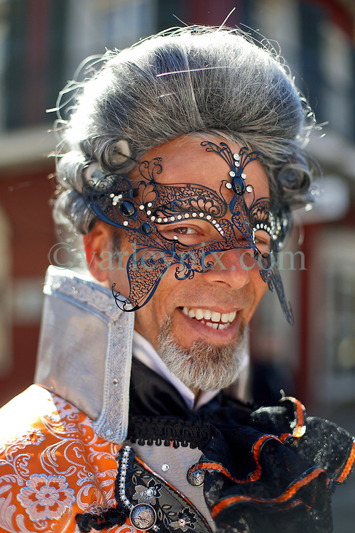 09 February 2016. New Orleans, Louisiana.<br /> Mardi Gras Day. A reveler in one of the many bright and colourful costumes in the French Quarter. <br /> Photo©; Charlie Varley/varleypix.com