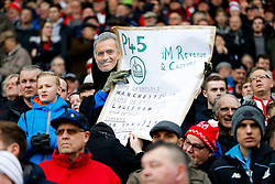 A Stoke City supporter dressed in a grim reaper gown and wearing a Jose Mourinho mask holds up a P45 poster suggesting Manchester United Manager Louis van Gaal may soon be out of a job - Mandatory byline: Rogan Thomson/JMP - 26/12/2015 - FOOTBALL - Britannia Stadium - Stoke, England - Stoke City v Manchester United - Barclays Premier League - Boxing Day Fixture.